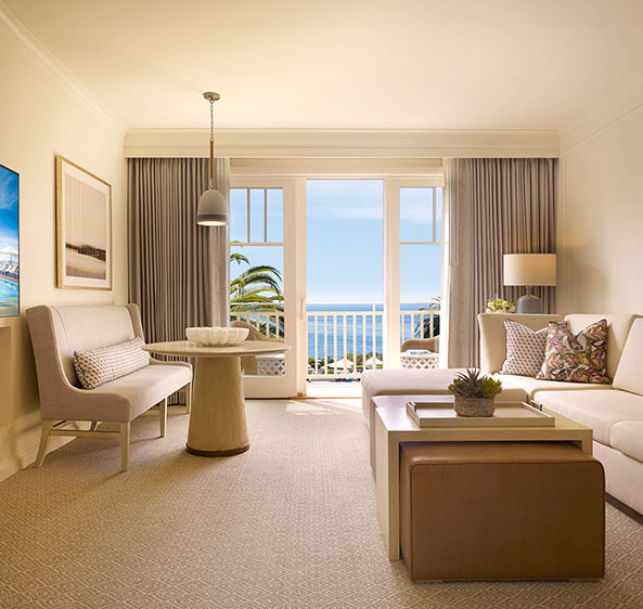 A small living room with a balcony overlooking the sea at Montage Laguna Beach hotel