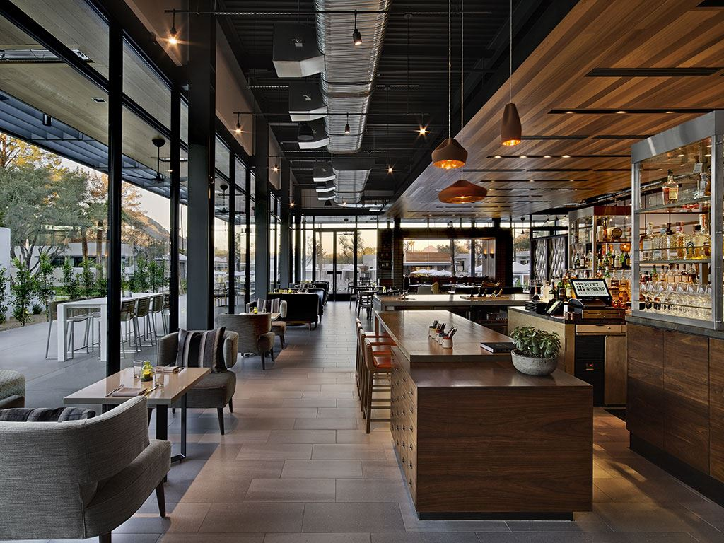 A long shot of the Andaz Scottsdale Resort restaurant with large glass windows