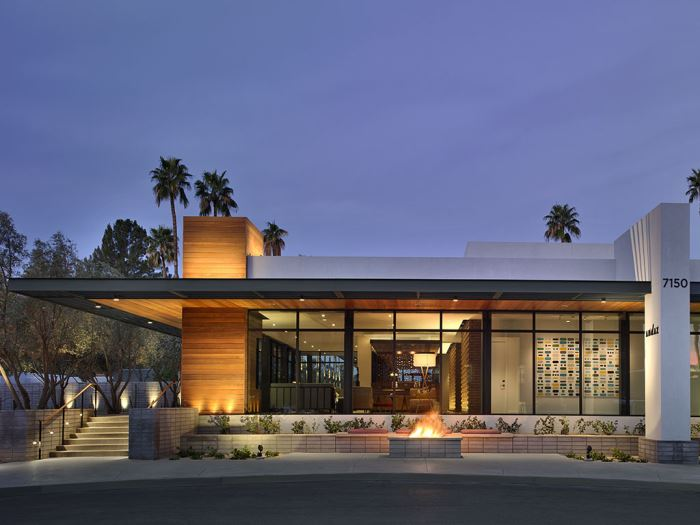 Exterior of the Andaz Scottsdale Resort at night with a fire place