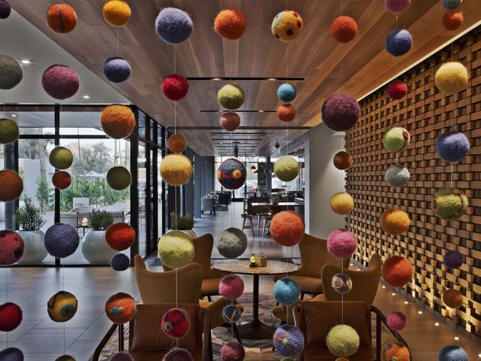 A shot of ornamental balls hanging in a Andaz Scottsdale lounge