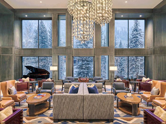 A large lounge overlooking snowfall at the at the Grand Hyatt Vail