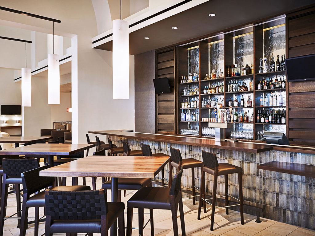 A small bar with stools and tall tables at the JW Marriott Phoenix Desert Ridge Resort & Spa