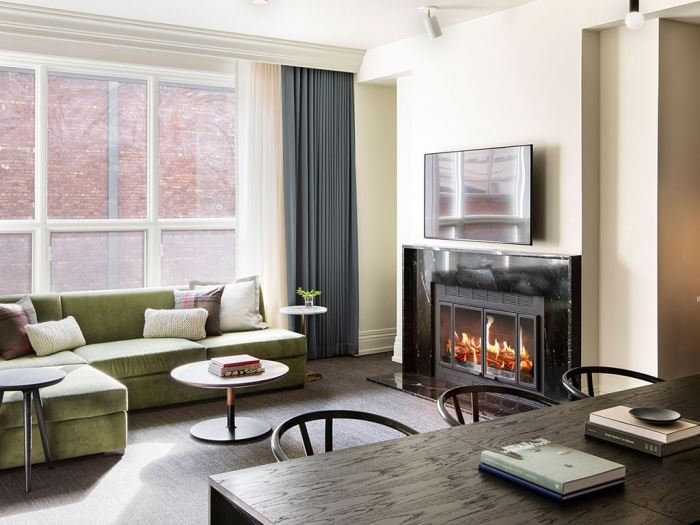 A living room with a fire place at the Kimpton Alexis Hotel