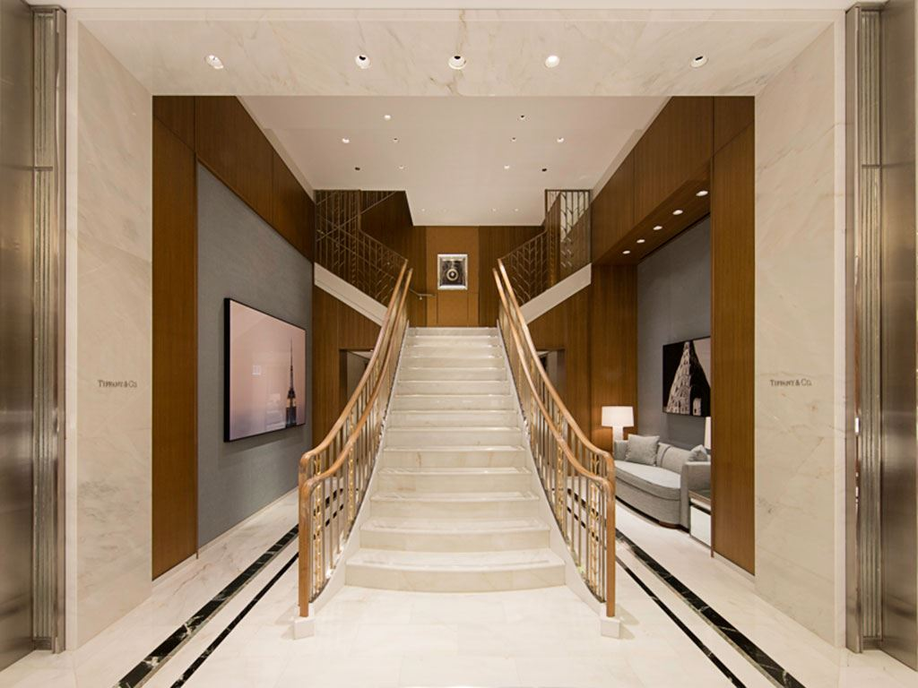 Stairs leading up to the second floor of a Tiffany & Co. store