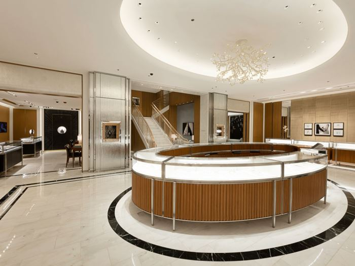 A look at a large round display case at the center of a Tiffany & Co. store