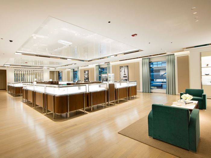 A large room with a giant rectangular display case inside a Tiffany & Co. store