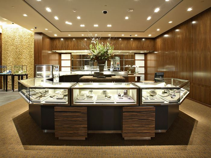 A closer look at a large pentagonal display case inside a Tiffany & Co. store